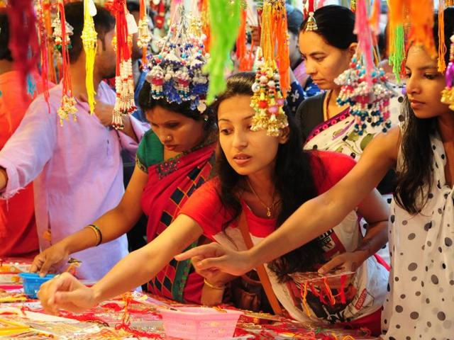 sisters buying rakhi for there brothers